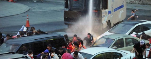 Police use a water cannon to disperse protestors outside Turkish Prime Minister Recep Tayyip Erdogan's working office in Besiktas Istanbul, on June 2, 2013, during a third day of clashes sparked by anger at his Islamist-rooted government.  White fumes filled the air as riot cops fired gas and lashed stone-throwing protestors with water-cannons in the two cities, the latest in a string of nationwide clashes that have left scores injured. AFP PHOTO /OZAN KOSE        (Photo credit should read OZAN KOSE/AFP/Getty Images)